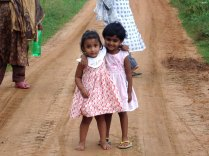 Two girls in pink dresses from Colombo, Sri Lanka thanks to 'Hishan'
