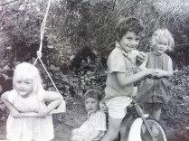 Us kids by the swing Dad made